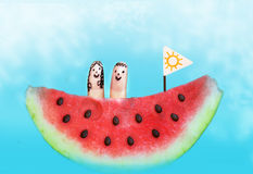 Water melon boat with finger kids on board. Happy summer sea picture Stock Images