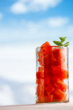 Water melon in glass on beach with seascape Stock Photos