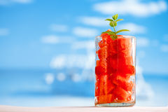 Water melon in glass on beach with seascape Royalty Free Stock Photography