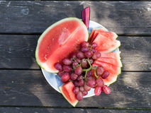 Water melon and grapes on a plate Stock Photography