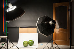 Water-melon in a photographic studio Royalty Free Stock Photos