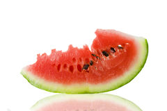 Water-melon piece. Small part cut off from a water-melon (on a white background Royalty Free Stock Images
