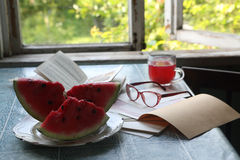 Water-melon piece on a plate, a recipe-book and points Royalty Free Stock Photos