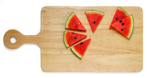 Water melon slice on wood plate isolated Royalty Free Stock Photos
