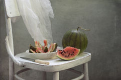 Water-melon on a white chair Royalty Free Stock Images