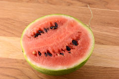 Water melon on wooden table Royalty Free Stock Photo