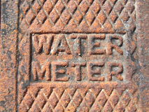 Water Meter. Rusted water meter cover Stock Photos