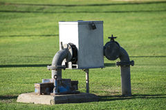 Water meter box, vent and water pipes Royalty Free Stock Image