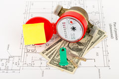 Water meter with cash and keys on draft Royalty Free Stock Photos