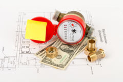 Water meter with cash and piping components Royalty Free Stock Photos