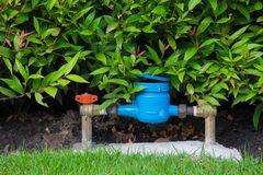 Water meter in the garden. royalty free stock image