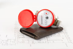Water meter with purse on draft Stock Photography