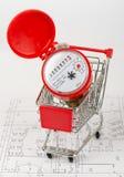 Water meter in shopping cart Royalty Free Stock Image