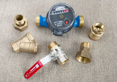 Water meter and various plumbing fittings Stock Image
