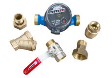 Water meter and various plumbing fittings Stock Photography