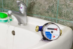 Water meter on the wash basin with handle mixer tap Stock Photography