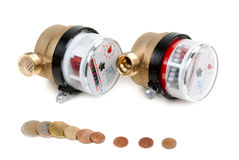 Water meters and coins with euro money Royalty Free Stock Images