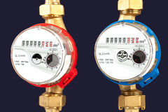 Water meters, sanitary equipment on dark background. Royalty Free Stock Photography
