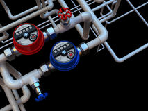 Water meters and taps. Communication of water meters and taps on a black background Stock Photo