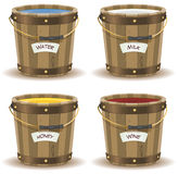 Water, Milk, Honey And Wine Inside Wood Bucket Stock Image