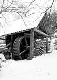 Water mill. Black and white image with covered water mill in winter Stock Photo