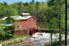 Water Mill. Old water mill on river bank Stock Photos