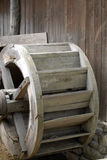 Water mill. A watermill is a structure that uses a water wheel or turbine to drive a mechanical process such as flour or lumber production, or metal shaping ( Royalty Free Stock Photography