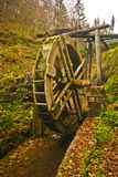 Water mill. Old water mill made from wood in the forest in autumn Stock Photos