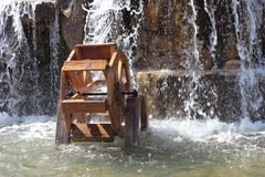Water mill in artificial pool stock photo