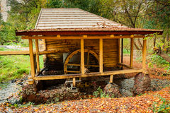 Water Mill in the autumn forest Stock Photos