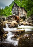 Water mill in Babcock Stat Park, West Virginia. Misty waters falling in stream in front of old water mill in Babcock State Park, West Virginia Stock Photo