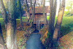 Water Mill in the forest Stock Photo