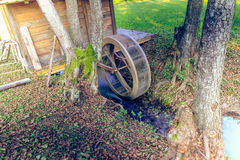 Water Mill in the forest Stock Images