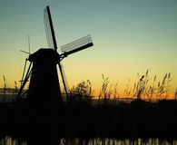 Water-mill in the night. Night scene with the water-mill in Kinderdijk Royalty Free Stock Photos