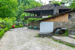 Water mill in traditional Balkan style in the ethnographic complex `Etera` in Bulgaria stock photos