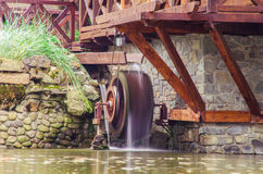Water mill. Vintage water mill with water on long exposition royalty free stock images