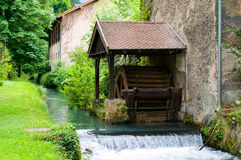 Water mill in Vizille park Stock Photo