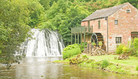 Water mill and water fall. Royalty Free Stock Image