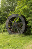 Water mill. Waterwheel of dismissed mill in the grass, detail of cushion Stock Images