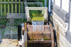 Water mill wheel in operation Stock Photo
