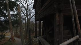 Water Mill Wheel at Skansen, Stockholm, Sweden. During cloudy day. Out of service stock video footage