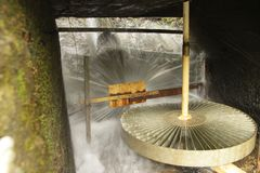 A Water powered  mill wheel. The Water mill wheel, when stoped. water power, circle. cave Stock Photo