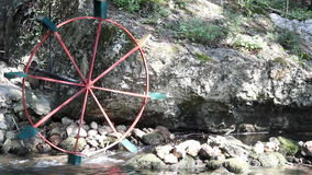 Water-mill wheel. Turning on river stock video
