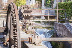 Water mills wheel. Old iron wheel a watermill. Ruins of a watermill Royalty Free Stock Photography