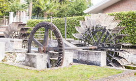 Water mills wheel. Old iron wheel a watermill. Ruins of a watermill Royalty Free Stock Image