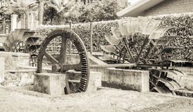 Water mills wheel. Old iron wheel a watermill. Ruins of a watermill. Effect vintage Royalty Free Stock Photography