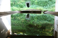 Water Mirror. A perfect water mirror in an old tank Royalty Free Stock Image