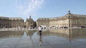 Water mirror fountain on Place de la Bourse in Bordeaux, France stock footage