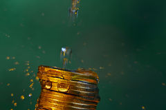 Water and money. Water drops and gold money Royalty Free Stock Images