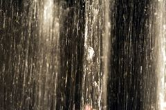 Water in motion. Slow shutter photograph of water from inside a lighted fountain at night royalty free stock photos